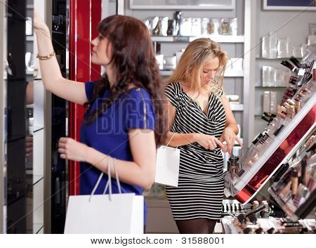 Women Buying Cosmetics In A Beauty Store
