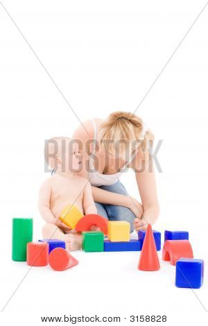 Mother Play With Little Daughter On Playground