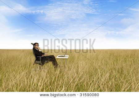 Businessman With The Freedom Of Working Anywhere