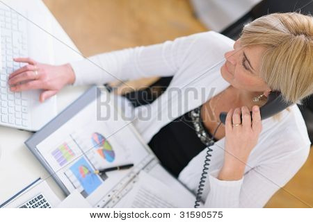 Mature Business Woman Making Phone Call. Top View