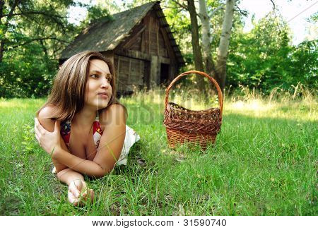 Young Woman On The Green Meadow