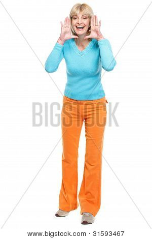 Happy Middle Age Woman Shouting Through Megaphone Shaped Hands