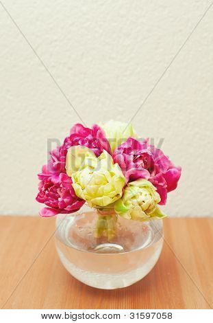 Tied Tulips In A Glass Vase On Table And Empty Space For Your Text