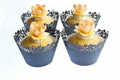 image of narcissi  - Cupcakes decorated for Spring topped with lemon frosting  - JPG