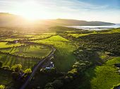 Aerial View Of Endless Lush Pastures And Farmlands Of Ireland. Beautiful Irish Countryside With Gree poster