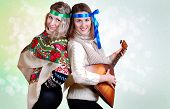 pic of mummer  - Two russian beauties with folk attributes on the shining light background - JPG