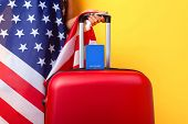 Passport With Usa Flag On Red Suitcase. American Visa, Work And Travel Concept, Suitcase With Hand O poster