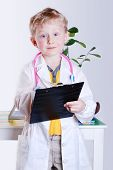 Smiling Little Boy In Doctor's Uniform