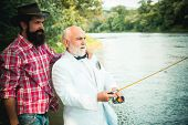 Fly Angler On The River. Father And Son Fishing. Fly Fishing For Trout. Happy Father And Son Togethe poster