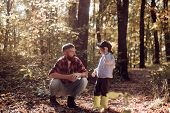 My Dad Cowboy. Hipster Bearded Dad With Cute Son Spend Time Together In Forest. Family Time. Family  poster