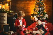 Family Holiday. Childhood Memories. Santa Boy Celebrate Christmas At Home. Boy Child Play Near Chris poster