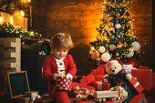 Family Holiday. Childhood Memories. Santa Boy Celebrate Christmas At Home. Boy Child Play Near Chris poster