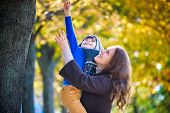 Cute, Happy, Boy Smiling And Hugging With His Mom Among Yellow Leaves. Little Child Having Fun With poster