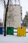 stock photo of waste reduction  - snow cover plastic bins for sorting waste - JPG
