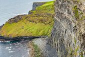 View Of A Side Wall Of A Cliff And Hills With Green Grass Along The Coastal Walk Route From Doolin T poster