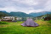 Norwegian Fjord Landscape With Camping Tent. Norway Adventure. Camping Tent At Scenic Wild Fjord, A  poster