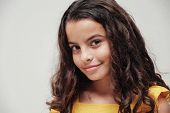 Close Up Portrait Of A Confident And Gorgeous Mixed Multicultural Preteen Girl With Beautiful Curly  poster