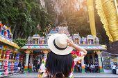 A Woman Tourist Is Sightseeing At Batu Caves In Kuala Lumpur, Malaysia. poster