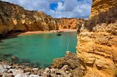 Praia da Dona Ana beach, Lagos, Algarve region, Portugal. Praia Dona Ana surrounded by steep colourf poster