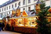 Traditional Christmas Market In The Historic Center Of Nuremberg, Germany. Decorated With Garland An poster
