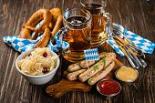 October Fest Concept - Traditional Food And Beer Served At Event, Wood Background poster