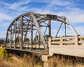 image of winona  - A closed and abandoned bridge in a field on the former path of Rt 66 near Winona AZ - JPG