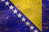 National Flag Of Bosnia Herzegovina On Old Peeling Wall Background.the Concept Of National Pride And poster