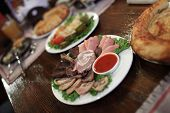 stock photo of collate  - The slices of meat as cold collation at a pub - JPG