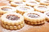 foto of linzer  - Closeup of Traditional Linzer Cookies on Wooden Board - JPG