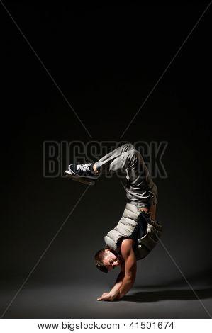 breakdancer in freeze. studio shot over dark background