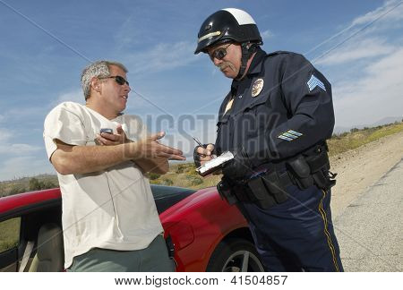 Man having discussion with police officer by car
