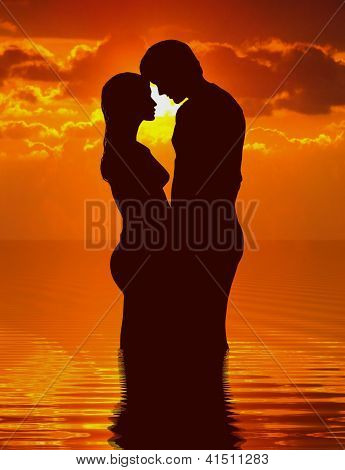 Loving couple under sunset