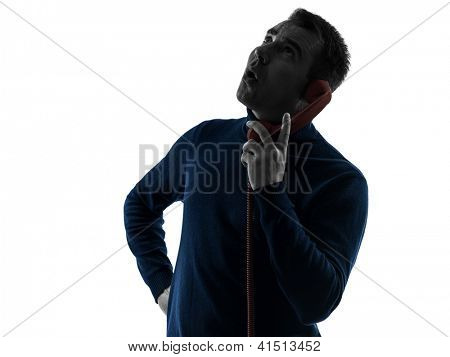 one caucasian man surprised on the phone portrait in silhouette studio isolated on white background