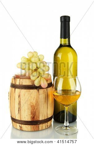 composition of wine and grapes on wooden barrel isolated on white