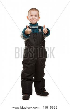Little smiling child boy hands gesturing thumb up success sign