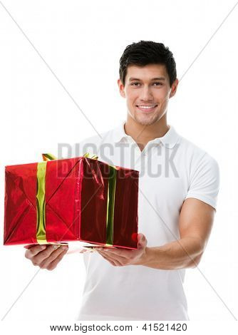 Offering a present wrapped in red paper sporty man, isolated on white