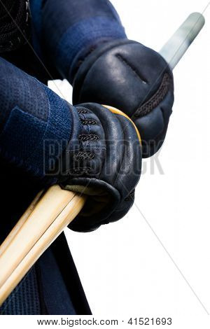 Close up of hands in kote with bokuto, isolated on white. Japanese martial art of sword fighting