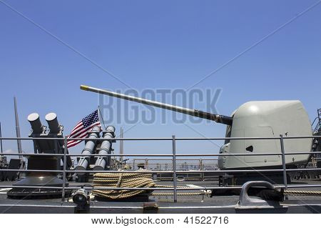 Harpoon cruise missile launchers and turret containing a 5-inch gun