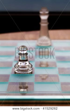 Pawn And King Chess Pieces - Business Concept - Strategy, Small Business, Growth, Mentor, Underdog.