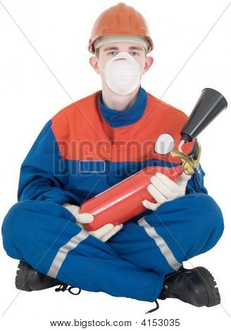 Man In Overllas And Fire-Extinguisher