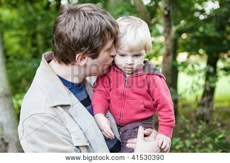 Young Father And Baby Boy In Spring Forest