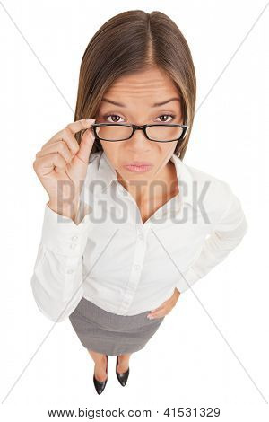 Suspicious upset angry and funny secretary taking off her glasses, standing isolated on white background in high angle. Multiracial Asian Caucasian business woman.