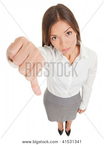 Sad young business woman making a thumbs down sign looking with disapproval background in high angle view in full length. Mixed race ethnic Asian Chinese / Caucasian businesswoman.