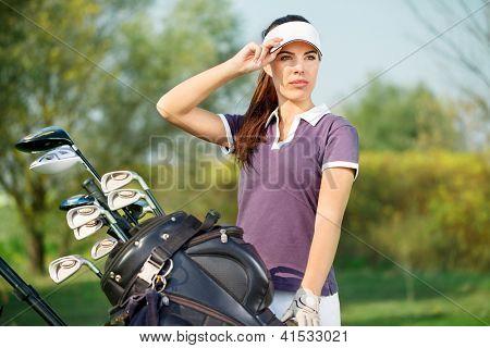 Beautiful woman golfer ready to play golf