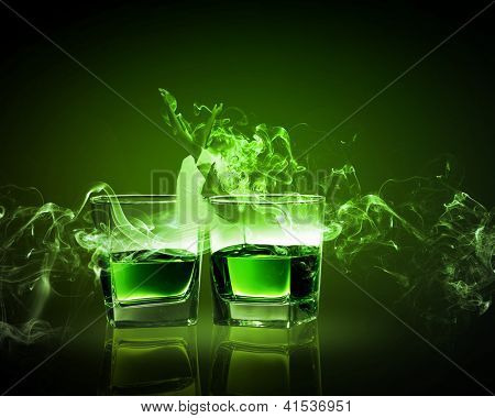 Two glasses of green absinth with fairy
