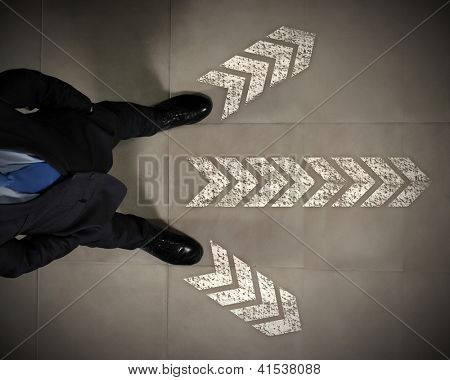 Top view of businessman standing against directions background
