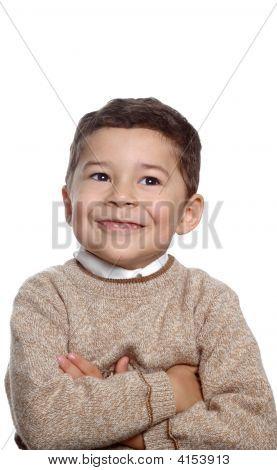 Five Year Old Boy In Tan Sweater