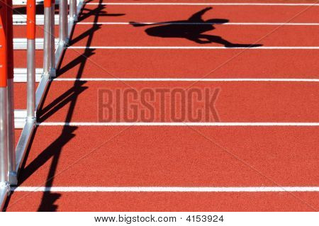 Shadow Of A Person Jumping Over The Hurdles