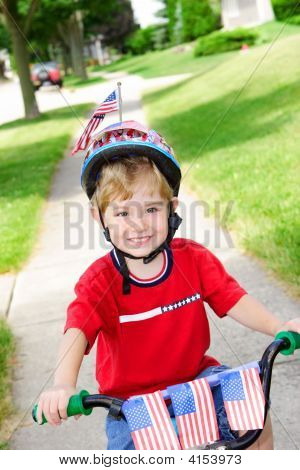 Boy On A Bike For The 4Th Of July Parade
