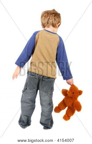 Boy Walking With His Homemade Teddy Bear